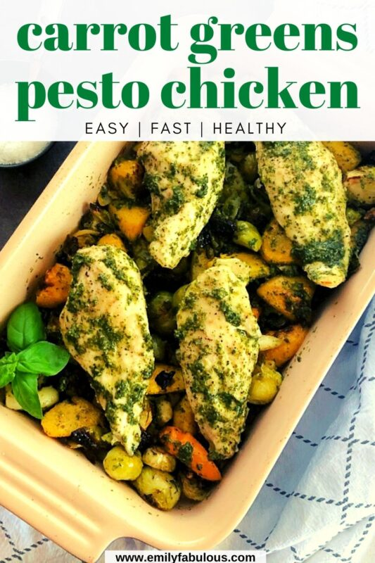 chicken and roasted veggies with carrot greens pesto in a baking dish