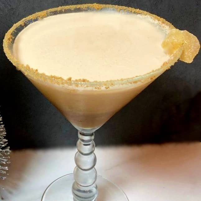 gingerbread martini with a candied ginger garnish