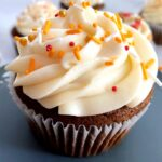 pumpkin molasses cupcakes with caramel apple frosting and fall sprinkles