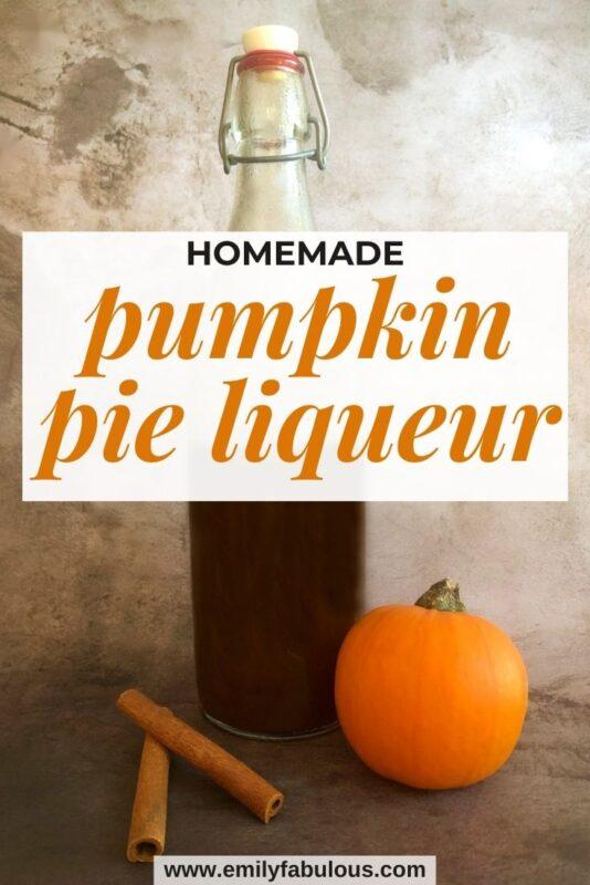 homemade pumpkin pie liqueur in a bottle with a small pumpkin and cinnamon sticks