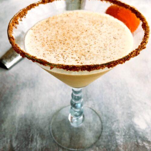 pumpkin spice martini with nutmeg garnish