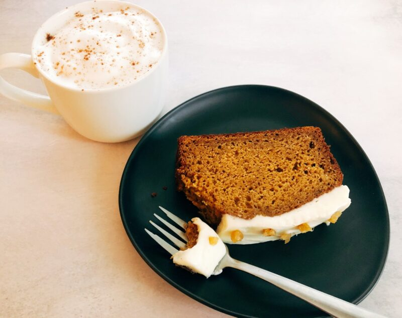 slice of pumpkin bread and a latte