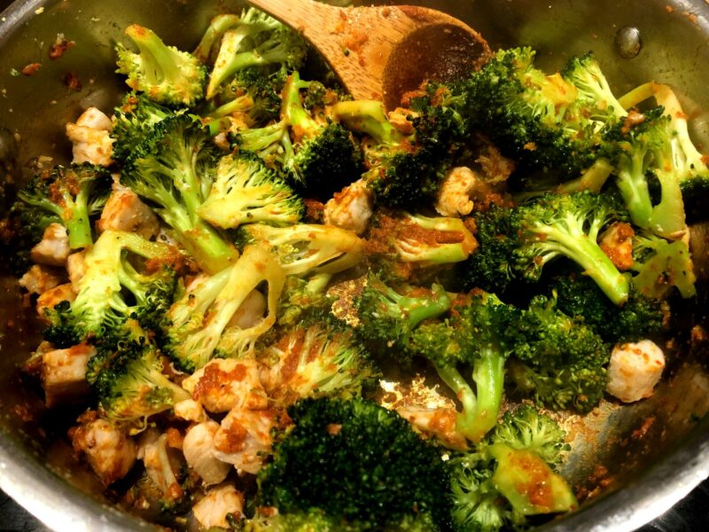 chicken and broccoli in thai red curry paste
