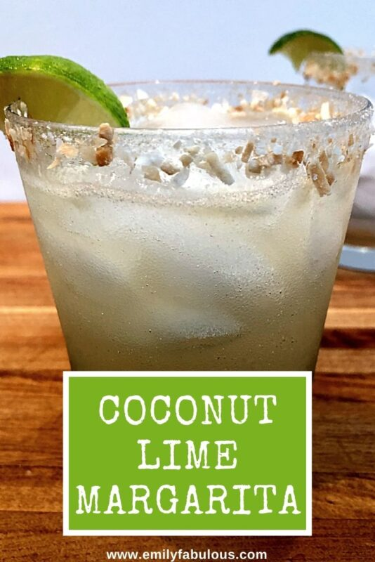 coconut lime margarita with a lime wedge and toasted coconut garnish