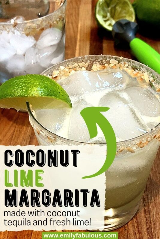 coconut lime margarita on ice with coconut rim and lime wedge
