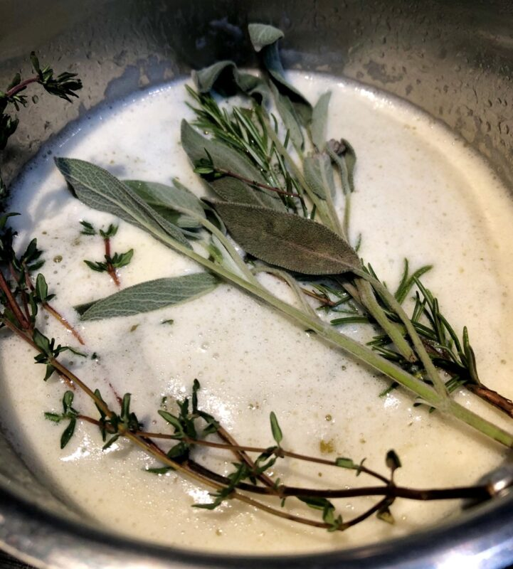 herbs in melted butter in saucepan