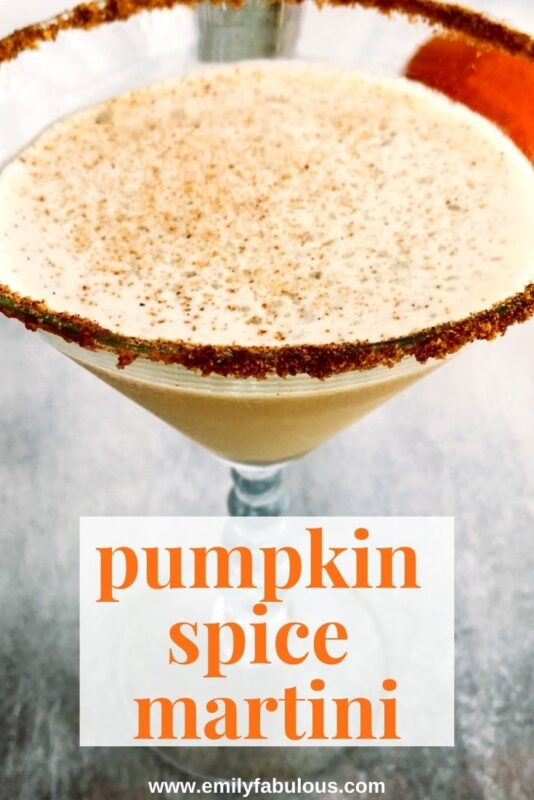 close up of a pumpkin spice martini with freshly ground nutmeg on top and a graham cracker rim