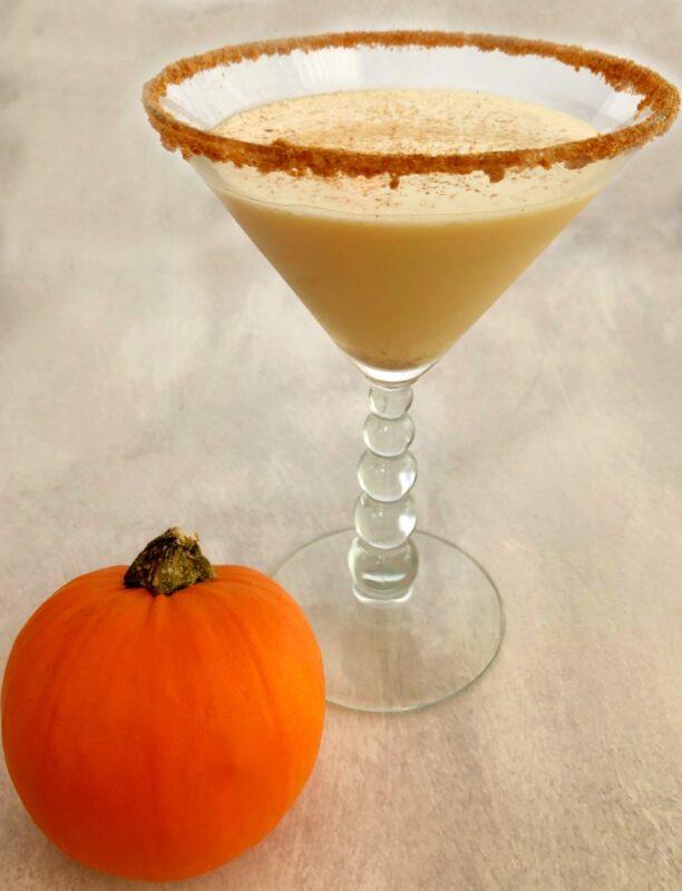 pumpkin spice martini with a small pumpkin