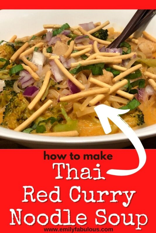 bowl of red thai curry noodles with chow mein on top