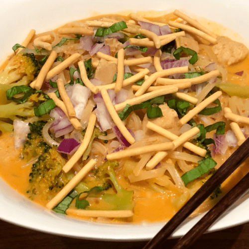 red curry soup with noodles and chow mein on top
