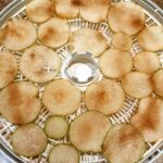 sliced asian pears with cinnamon and sugar in dehydrator