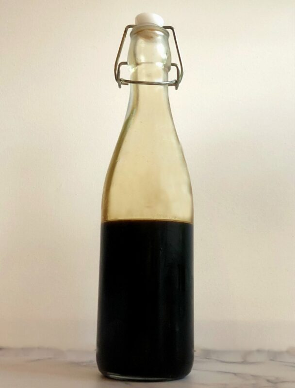 bottle of homemade gingerbread syrup