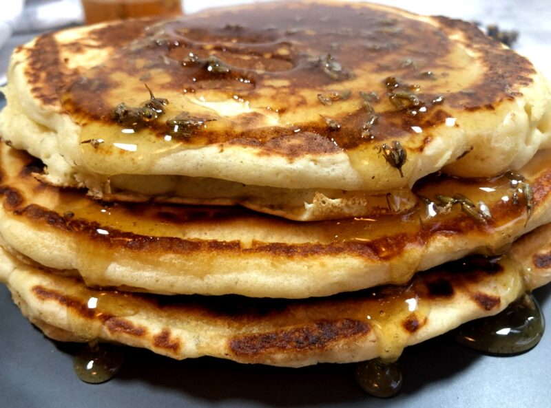 lavender pancakes with lavender honey that has lavender buds