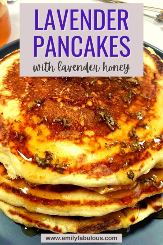 lavender pancakes on a plate with lavender honey and dried lavender buds