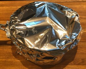 pan with cranberries wrapped in foil