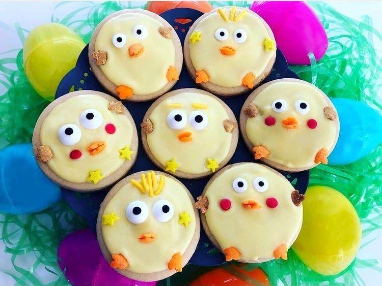 chick sugar cookies with yellow frosting and sprinkles