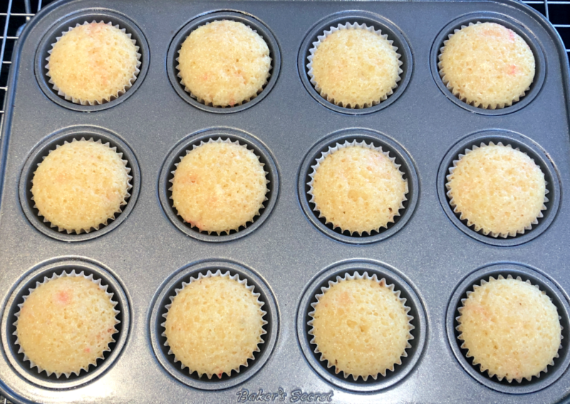 mini candy cane cupcakes baked in a cupcake pan