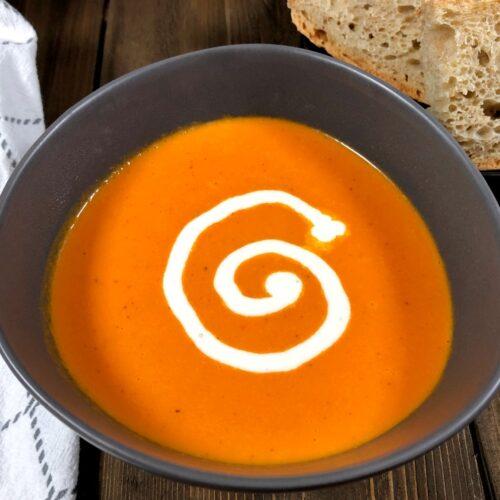 orange tomato soup with bread