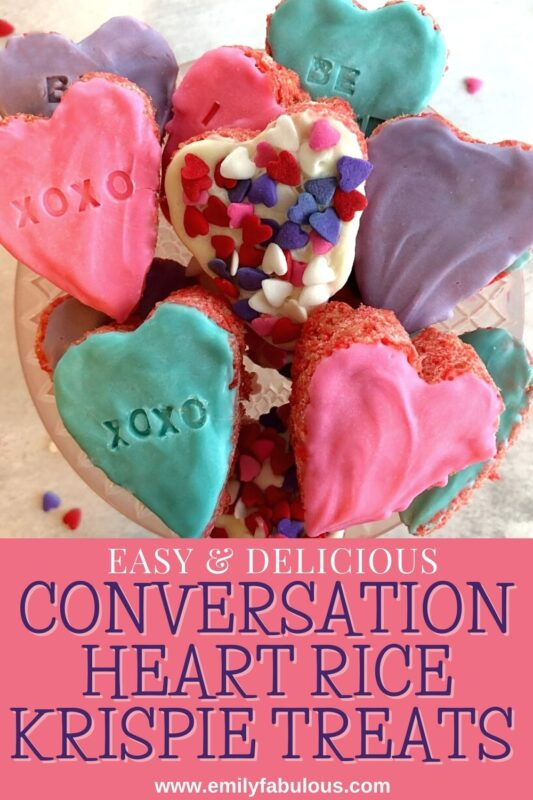 conversation heart rice krispie treats with sprinkles and candy coating on a cake plate