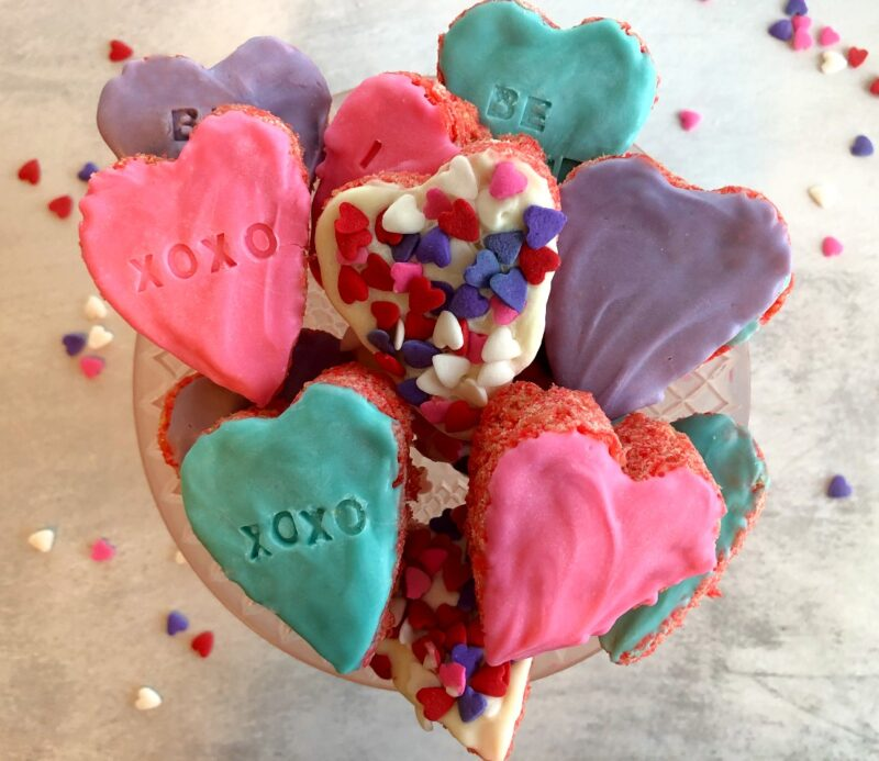 rice krispie valentine hearts on a cake plate