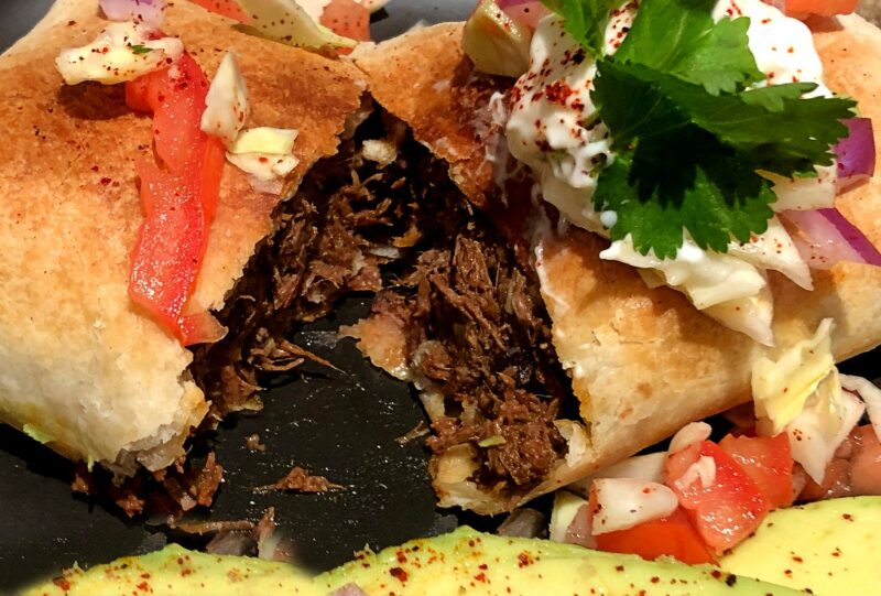 shredded beef chimichanga made in the air fryer cut in half