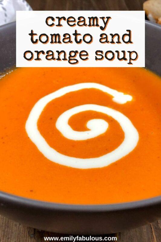 a bowl of tomato orange soup with cream