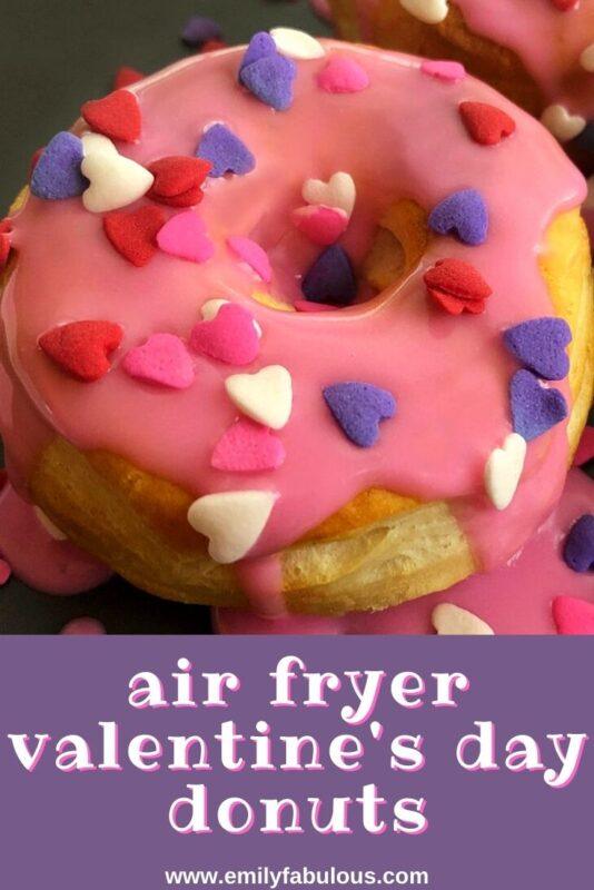 Valentine's Day donut made in the air fryer from biscuits with pink frosting and heart sprinkles