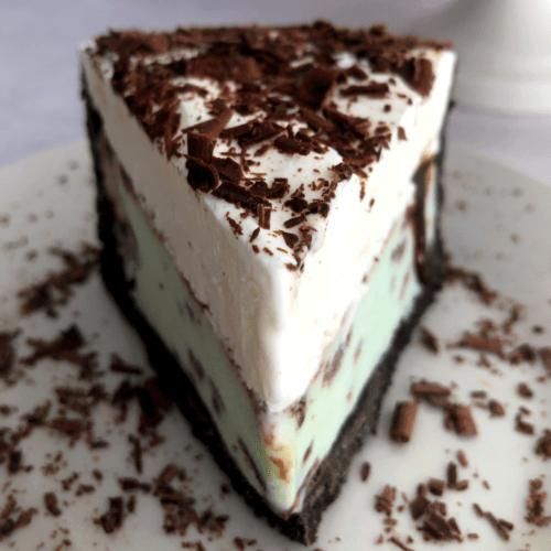 a slice of oreo mint ice cream pie on a plate