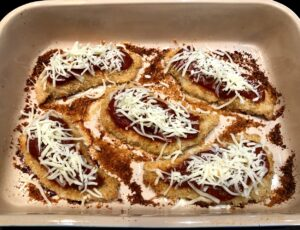 baked chicken with marinara sauce and cheese on top