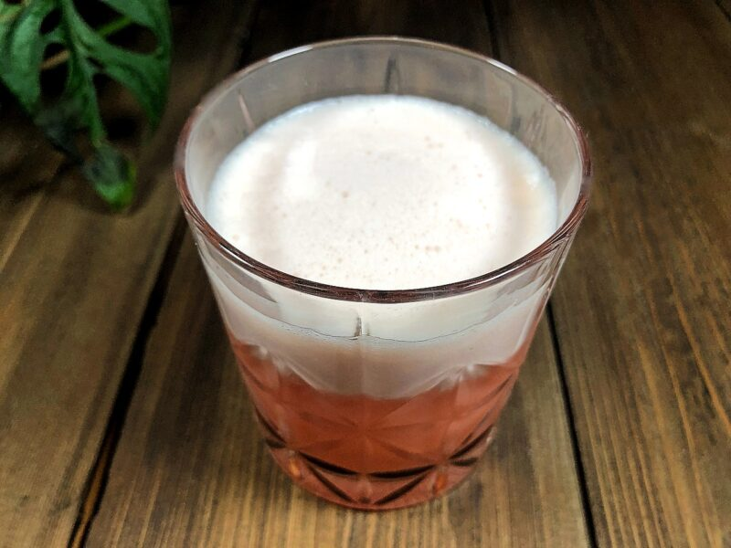 blood orange whiskey sour with egg white foam on top