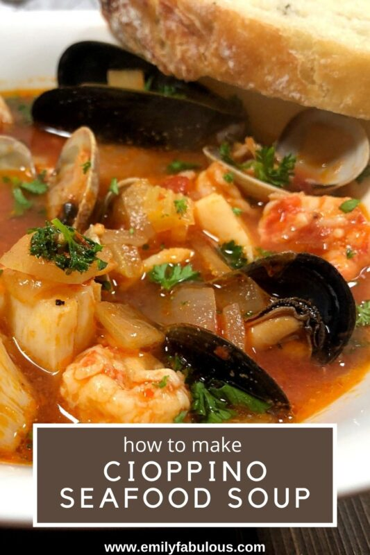 a bowl of fresh cioppino with shrimp, mussels, clams, fish and scallops
