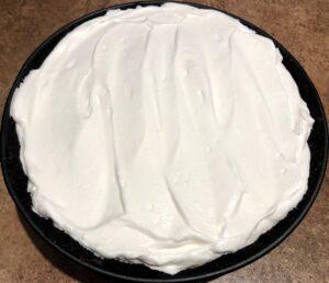 oreo ice cream pie with whipped cream on top