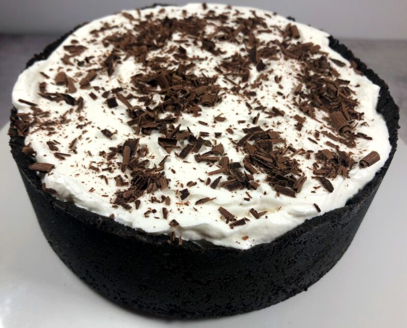 oreo crust mint ice cream pie on a pie plate with chocolate shavings on top