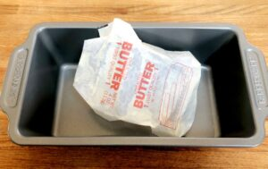 bread loaf pan with a butter wrapper