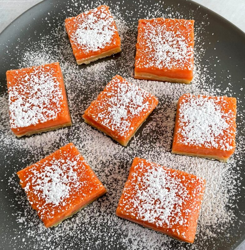 grapefruit bars with powdered sugar on top