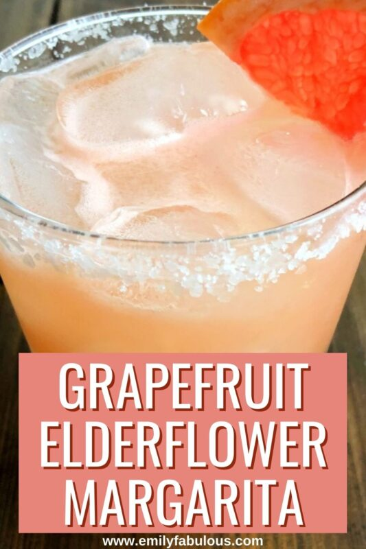 grapefruit elderflower margarita in a glass with ice and salt on the rim