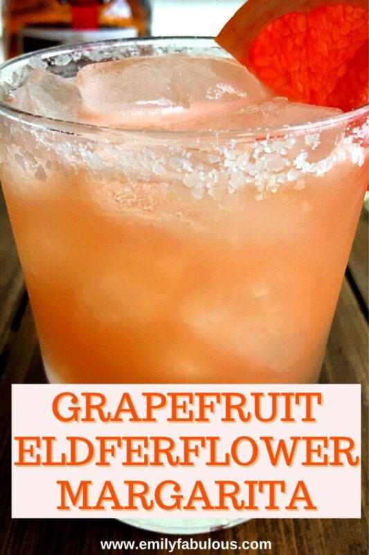 a grapefruit elderflower margarita with a slat rim and a slice of grapefruit on the side