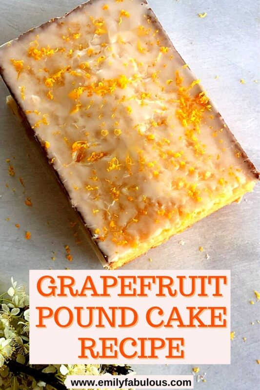 grapefruit pound cake with a slice taken out and zest on top