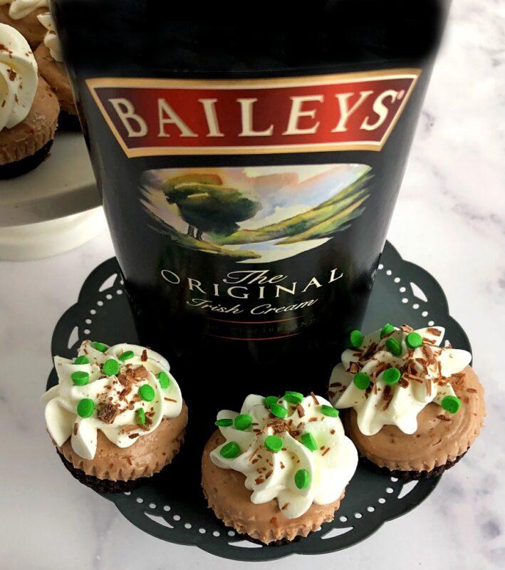irish cream cheesecakes and a bottle of irish cream liqueur