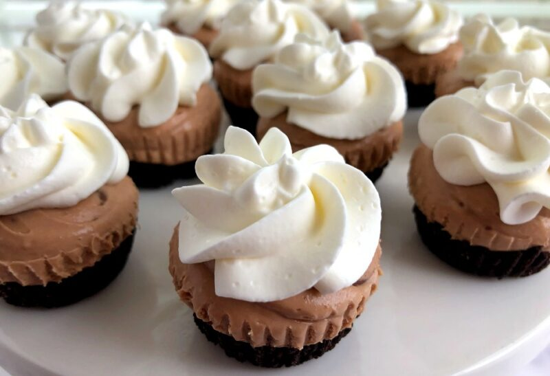 mini irish cream cheesecakes with whipped cream on top