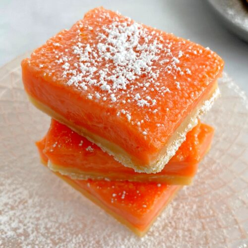 stacked grapefruit bars with sugar on top