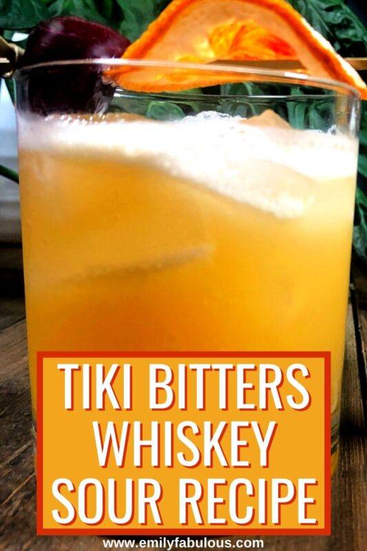 tiki bitters whiskey sour with a cherry and orange garnish
