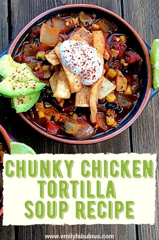 a bowl of chunky chicken tortilla soup with sour cream