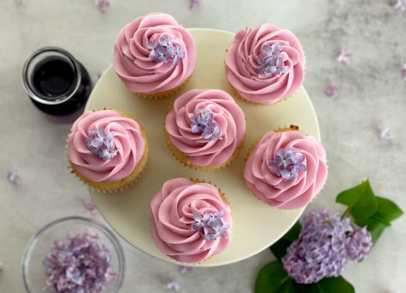 lilac cupcakes with fresh lilac flowers on top