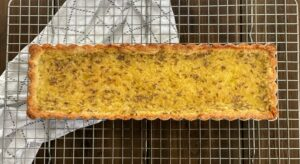 baked lemon lavender tart on a cooling rack