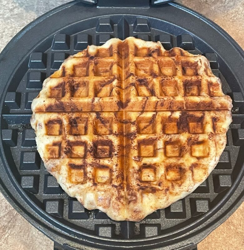 cinnamon roll cooked in a waffle iron