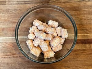 frozen tater tots in a glass bowl
