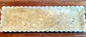 lavender tart crust in a tart pan before baking