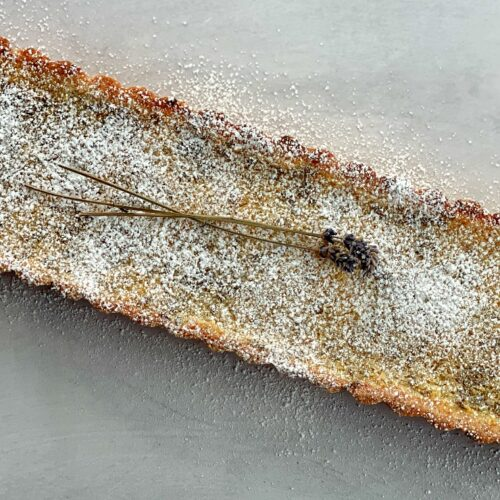 lemon lavender tart with powdered sugar on top