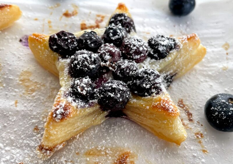 puff pastry star with blueberries and powdered sugar on top